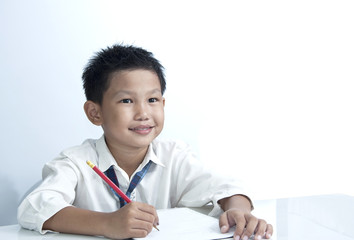 the young boy holding pencil white background
