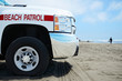 Beach Patrol vehicle at the ocean