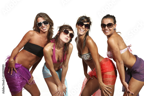 portrait of four sexy girls in studio, white background