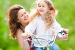 young mother and her daughter on bicycle