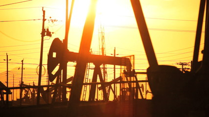 Fossil Fuel Production at Sunset
