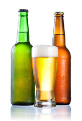 Brown and green bottles full of condensate and covered with a gl