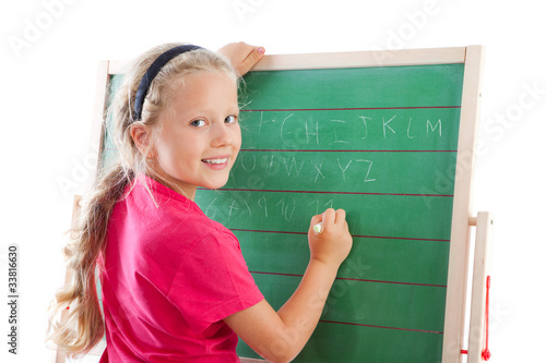 education girl writing on blackboard