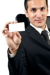 Business man holding a blank visiting card