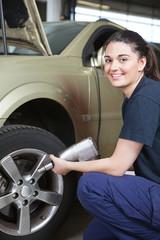 Happy Woman Mechanic Tire Change