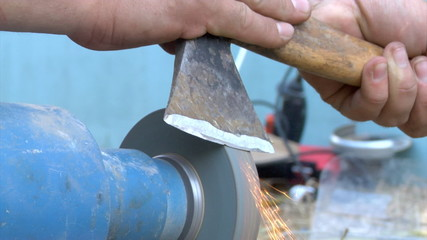 close-up grinding the axe
