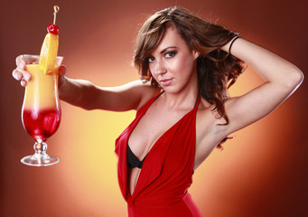 Striking woman in red and Tequila Sunrise cocktail