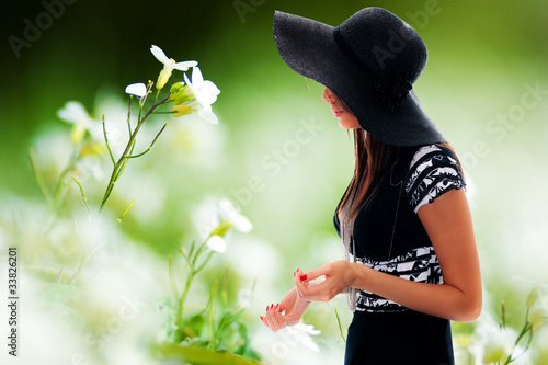 Beautiful young lady and flowers
