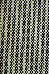 White metal plate with many small circular holes