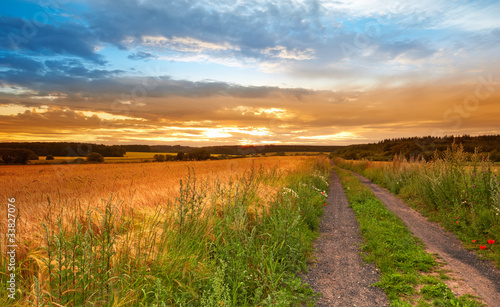 A sunset photo of road and countryside