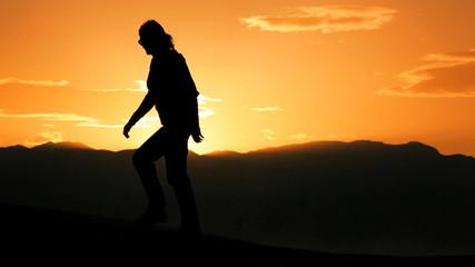 Solitary Female Hiker in Desert Environment