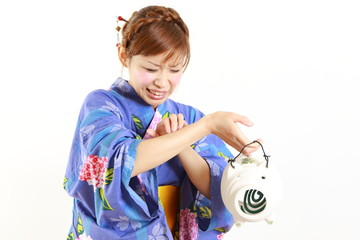 Young woman wearing Japanese kimono,bitten by mosquito