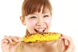 young japanese woman with grilled corn