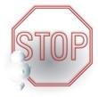 3D Figur vor STOP-Schild
