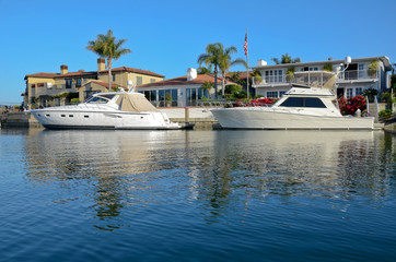 A boat in Newport Beach, California outside of a home.