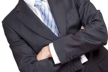 Hombre de negocios cruzando los brazos