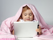 Portrait of cute little girl playing with touchpad