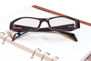 Eyeglasses with Notebook on a white background