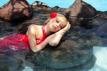 beautiful girl lying in the water