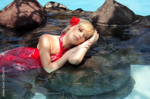 beautiful girl lying in the water