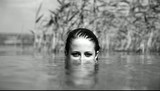 Girl in the river. Video in noisy black and white style.