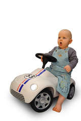 Baby driving a little car
