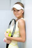 beautiful girl with a tennis racket