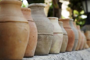 Row of ornamental clay pots