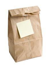 Lunch bag with stick note on white