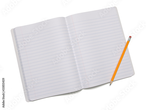 Pencil laying on opened composition notebook isolated on white