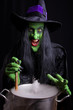 Evil witch stirring her misty cauldron, black background.