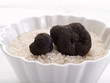 truffle over raw rice on bowl