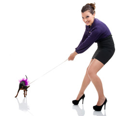 girl pulling  little dog