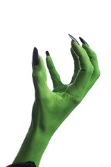 Witch's green hand, white background.