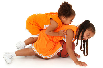 Two Adorable African-Hispanic Girls Playing Basketball