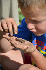 Boy Looking at a Worm on His Hand
