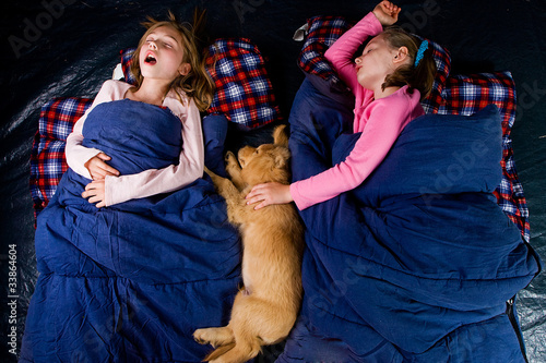 sleeping kids camping in a tent
