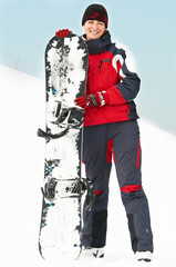 Happy woman with snowboard
