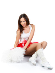Young lady cheerleader posing in the studio, isolated on white