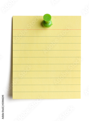 Yellow note pad pinned on white background