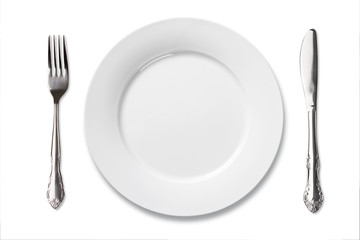 white china plate with silver fork and knife isolate on white