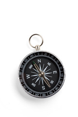 Close up of a compass with soft shadow on white background.