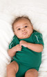 ethnic multiethnic mulatto Baby boy in green outfit