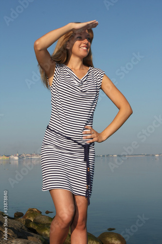 Woman in dress with stripes