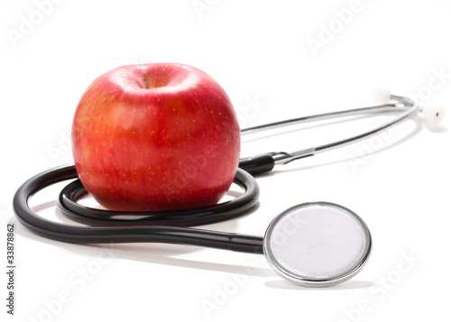 Doctors stethscope and red apple on white