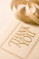 Close up of thank you card with ribbon