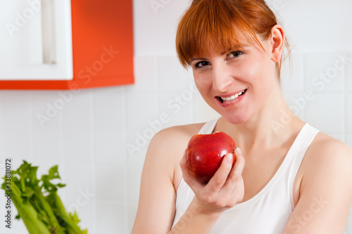 Healthy eating - woman with apple