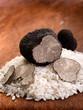 sliced black truffle over wood background