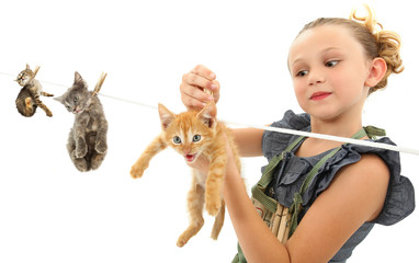 Image Manipulation of Girl Hanging Kittens on Clothes Line