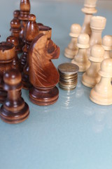 Chess soldiers fight for stack of coins